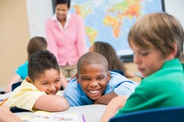 Boy being bullied in elementary school class